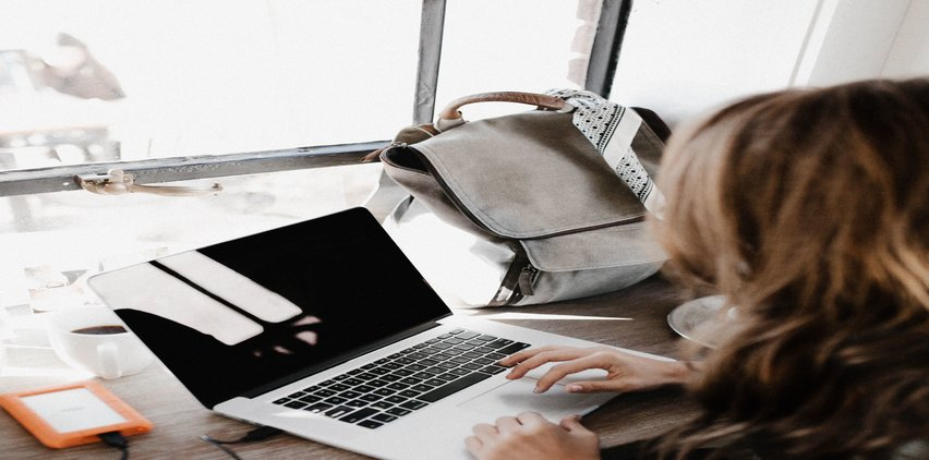 woman using email on laptop to make money freelancing