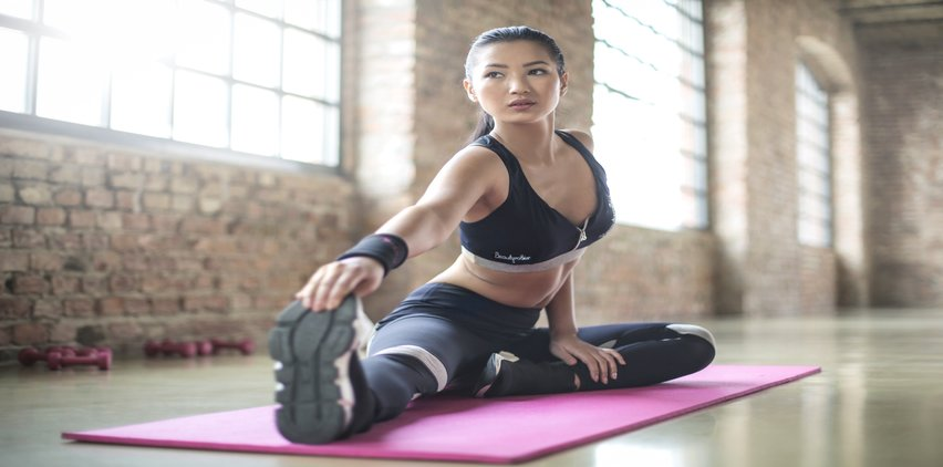 asian woman practicing yoga for calm mind