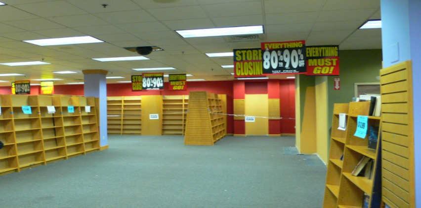 empty bookshelves store closing freelance