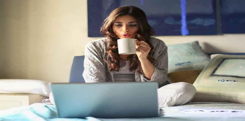 woman on bed freelance writing
