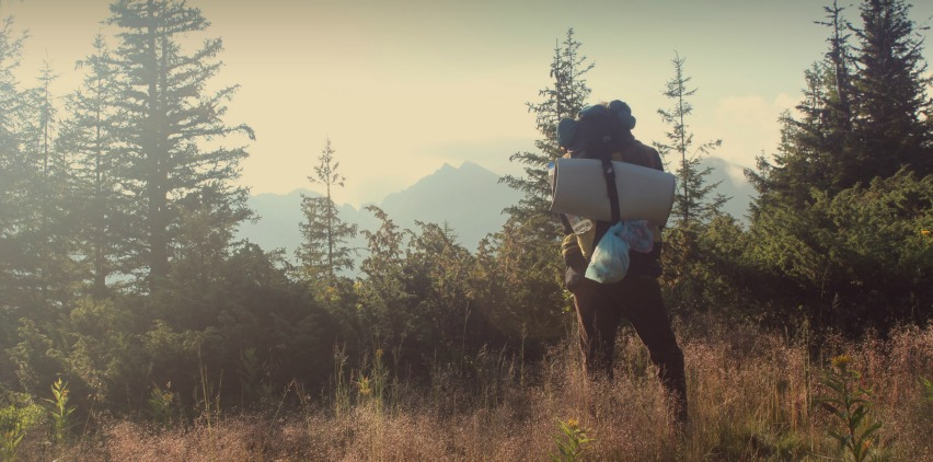 person hiking outdoors avoiding allergies