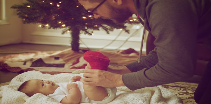 dad playing with baby christmas