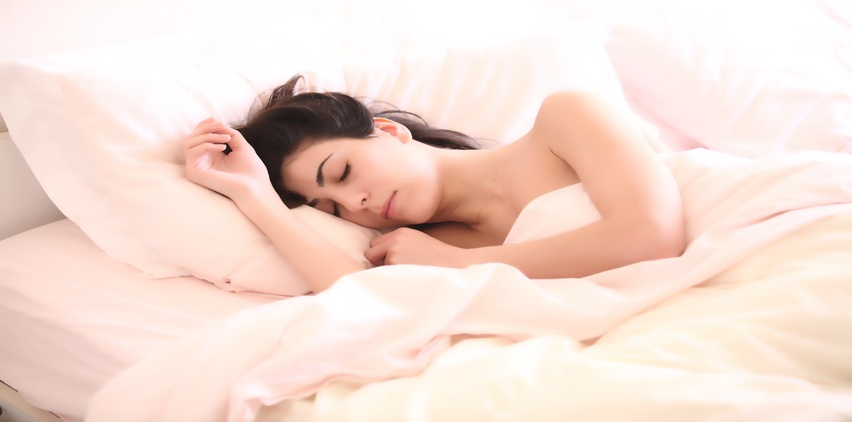 woman sleeping for skin health