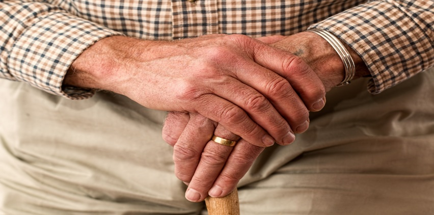 senior sad holiday blues man holding hands