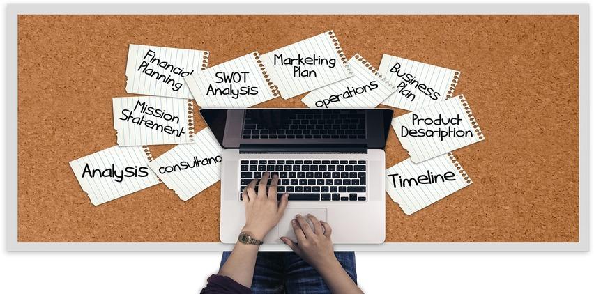 Laptop freelance writing stick postit notes to do list
