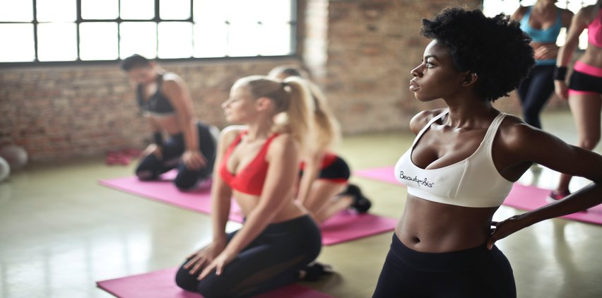 women with beautiful skin exercising