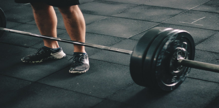 barbell with heavy weight get started exercising