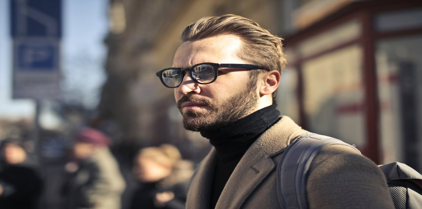 man wearing glasses with aMD