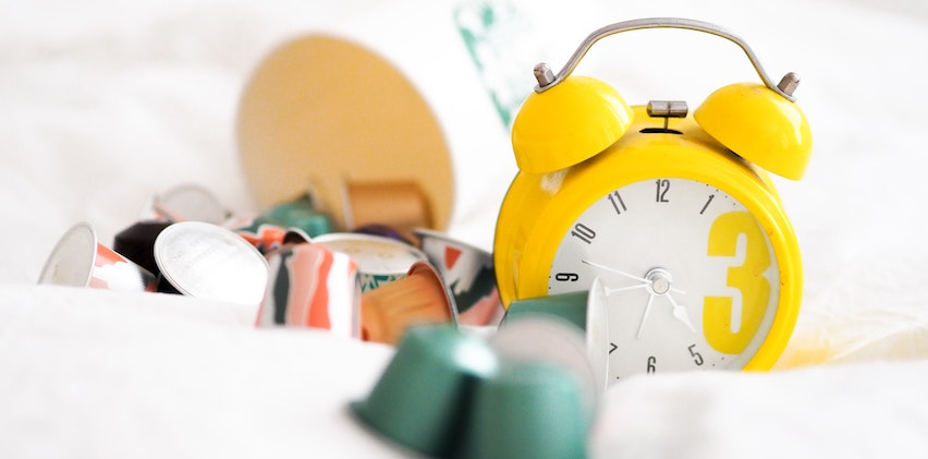 Photo of clocks sitting in a pile