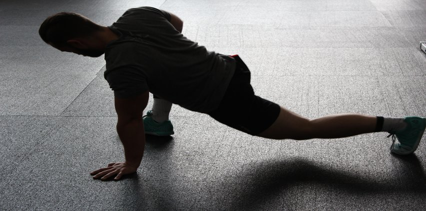 man stretching motivated to work out