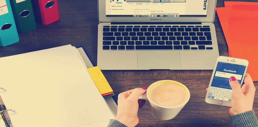 laptop drinking coffee time management mistakes