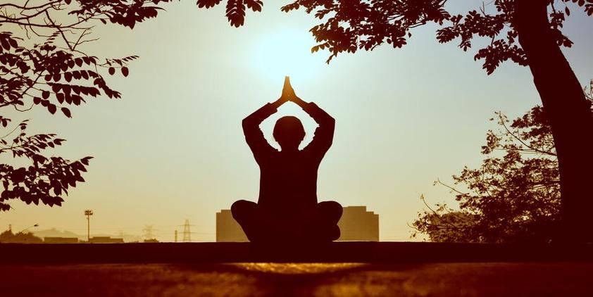 Pexels. Woman meditating at sunset
