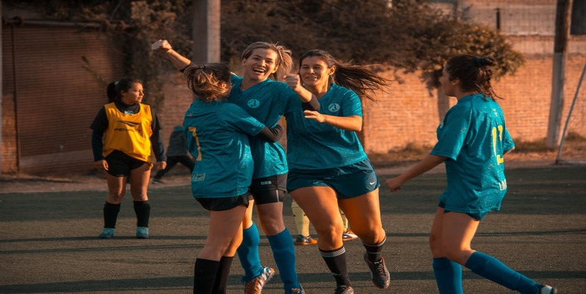 Female soccer teen athletes celebrating