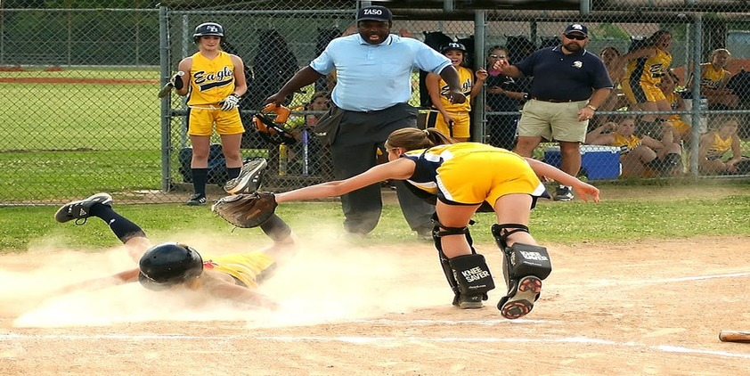female athletes playing softbal