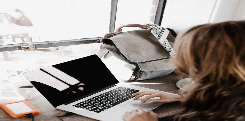 woman using email on laptop to make money freelancing