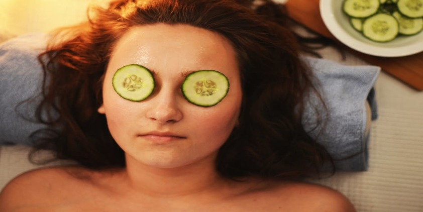 Pexels. Woman getting a facial with cucumbers on her eyes
