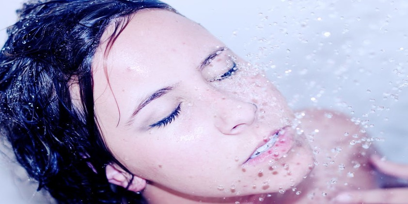 Pexels. Brunette woman washing her face