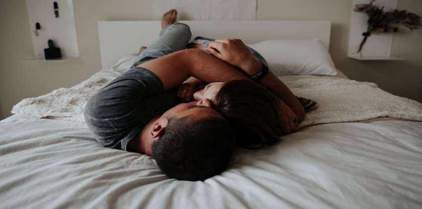 couple cuddling in bed sleeping