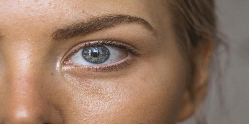 Unsplash. close up picture of woman's blue eye