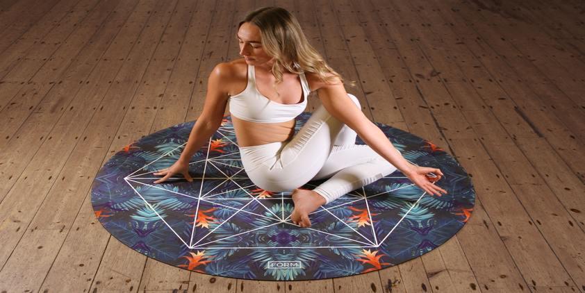 Unsplash. Woman in white yoga outfit doing yoga on mat on hardwood floor