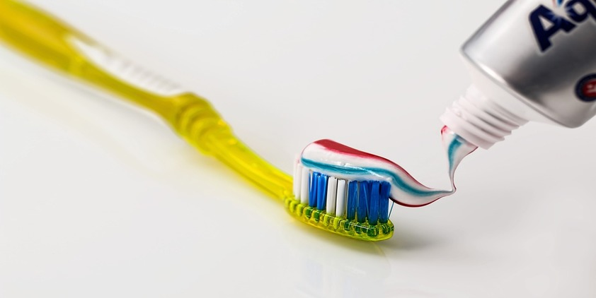 Pixabay. Red, white and blue toothpaste on a yellow toothbrush
