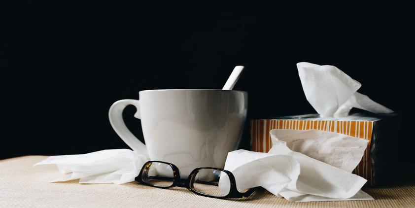 Unsplash white coffee mug and spoon, orange tissue box, and glasses on table