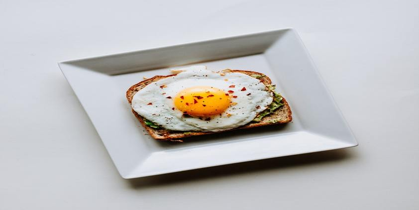 Unsplash. whole wheat toast with avocado and an egg.