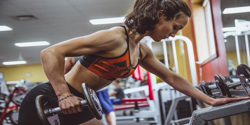 Unsplash. woman in orange sports bra lifting weights