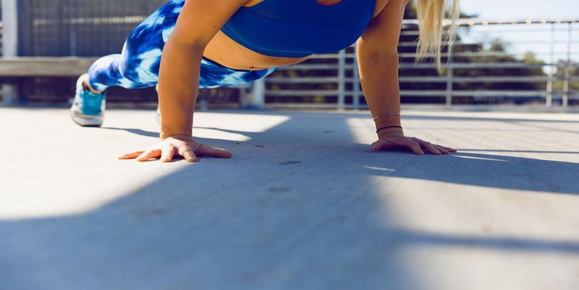 unsplash. woman planking on concrete.