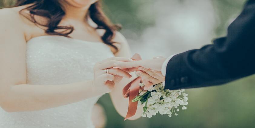 unsplash. woman giving wedding ring to man