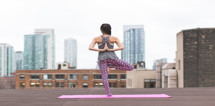 woman with strong shoulders doing yoga pose