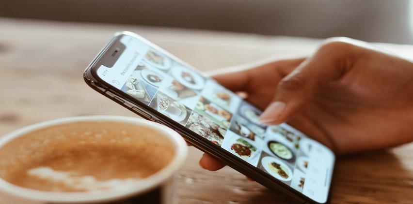 woman on phone drinking coffee