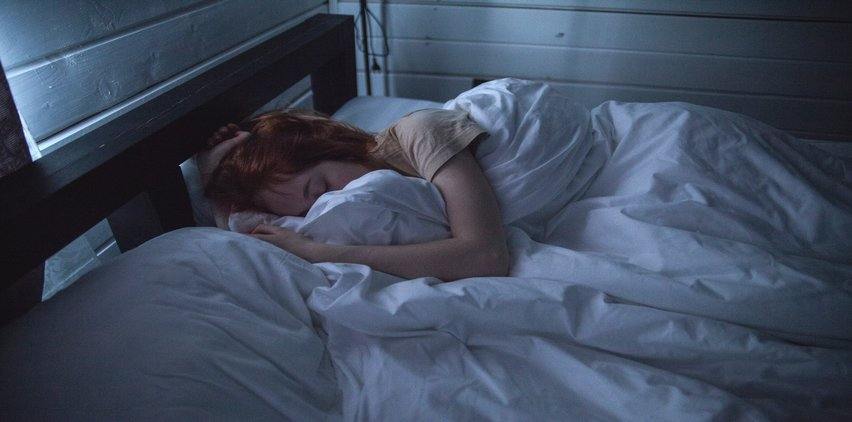 woman sleeping in bed alone