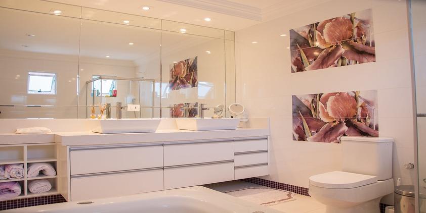 pexels. clean bathroom with pink and purple paintings