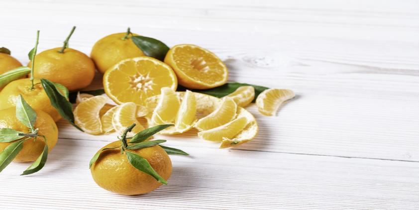 Unsplash. cut up oranges on white table