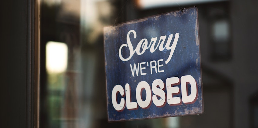"""Sorry we're closed"" sign to represent freelance business slowdowns in summer"