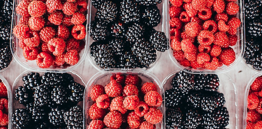 Baskets fo raspberries and blackberries.