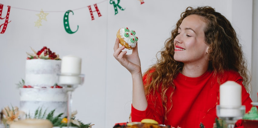 A woman holding a holiday treat