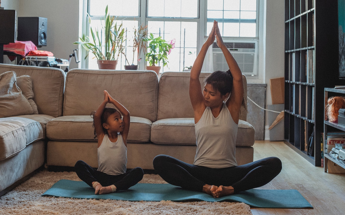 A mom doing yoga with her child