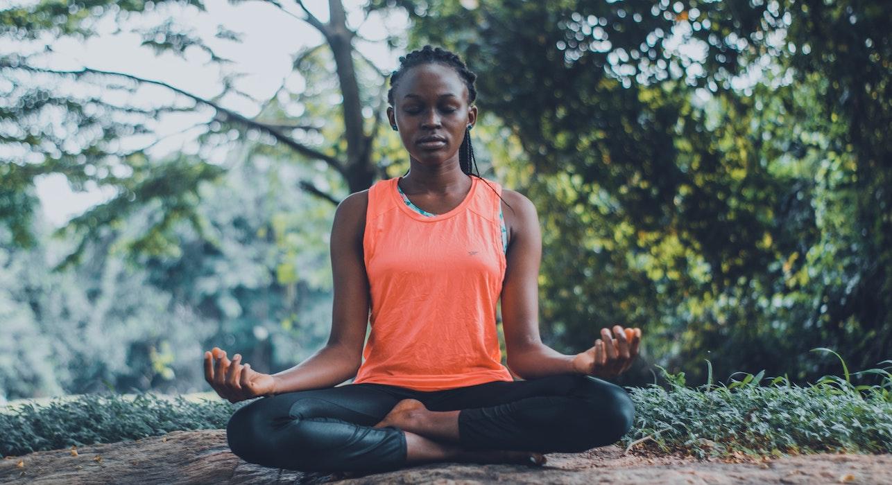 A woman meditating outside