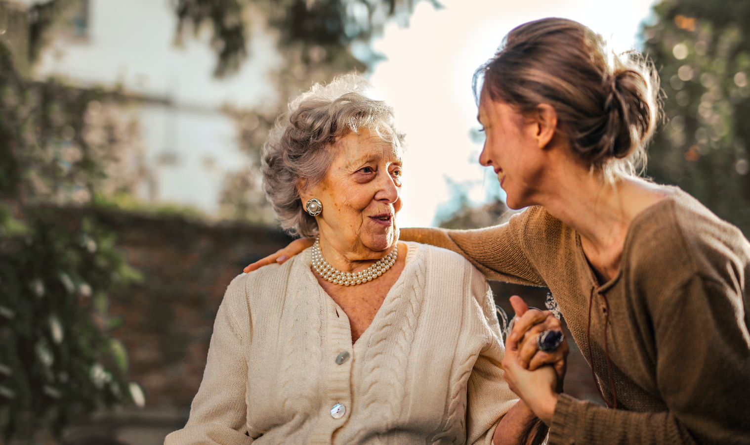 A woman chatting with an elderly woman