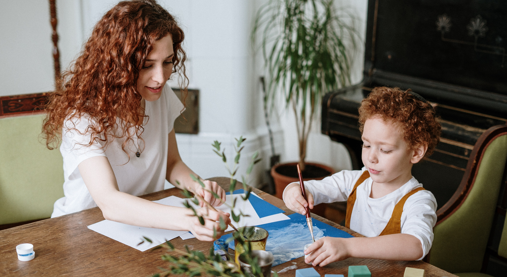 A woman painting with her child
