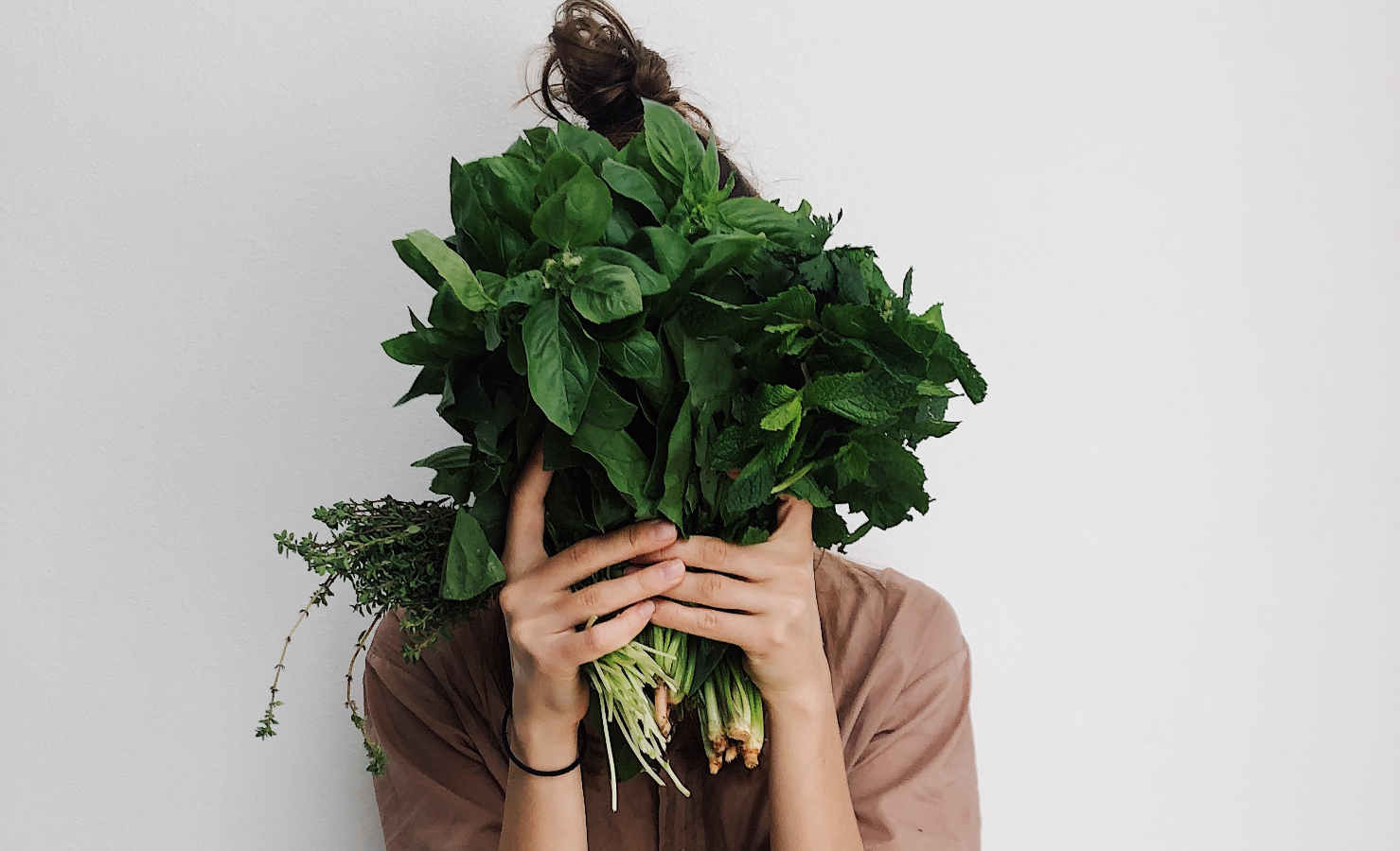 A woman holding leafy greens